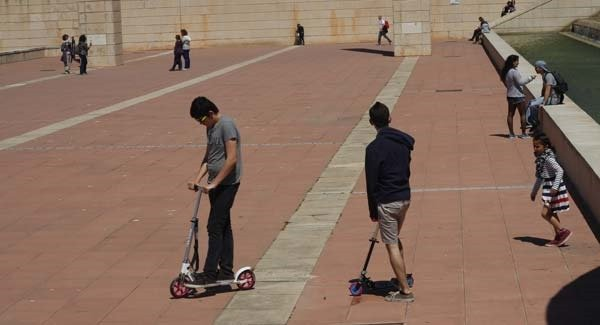 the kids enjoyed the scooters and rode in big wide open spaces in Barcelona