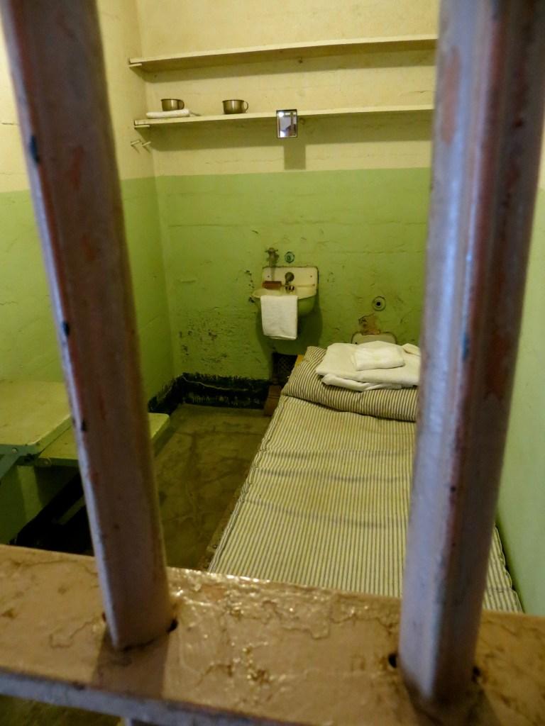 Inside a prison cell in Alcatraz Prison, California