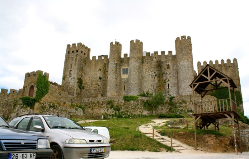 New meets Old in Obidos. You can see cars parked in front of the castle.