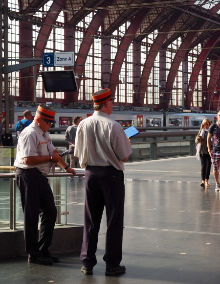 Workers in Train Station in Antwerp, Belgium