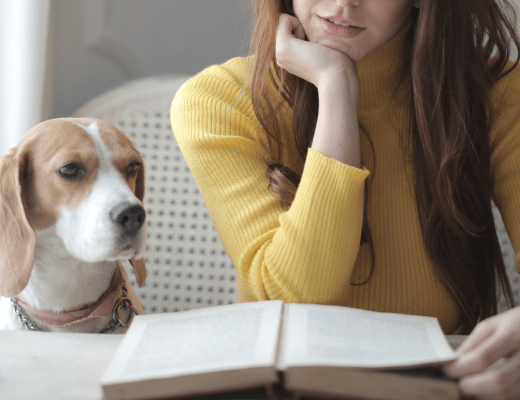 Woman With Dog Reading Book