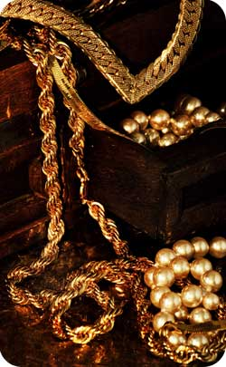 gold jewelry and chains to represent the golden wedding