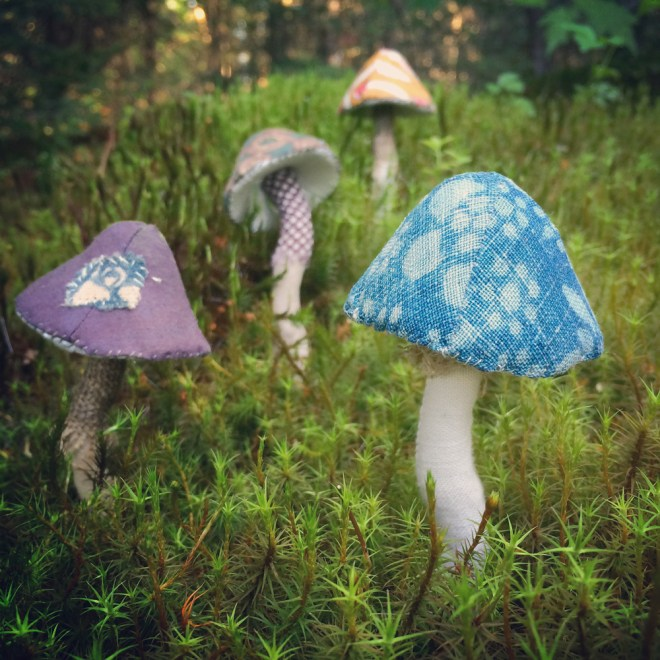 hand sewn toadstools in moss