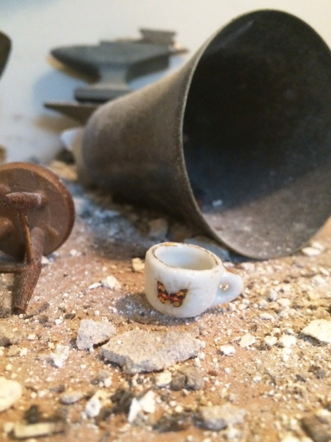 tiny tea cup among the rubble