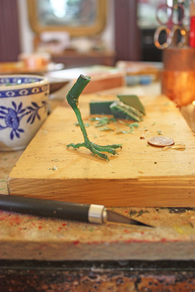 carving a wax bird leg for casting in bronze