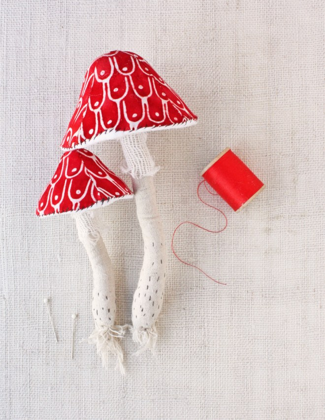 stitched red toadstools make from a kit