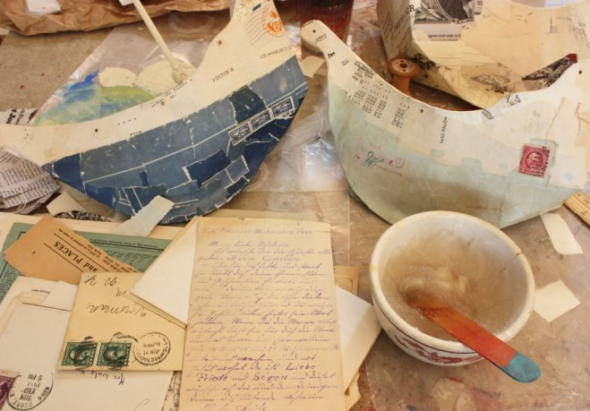 paper mache ship with antique paper