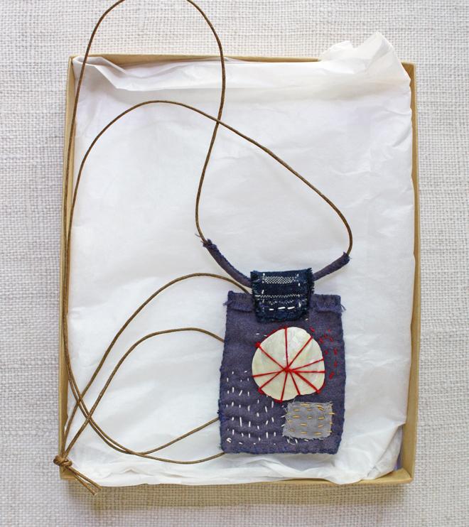 hand stitched textile amulet necklace