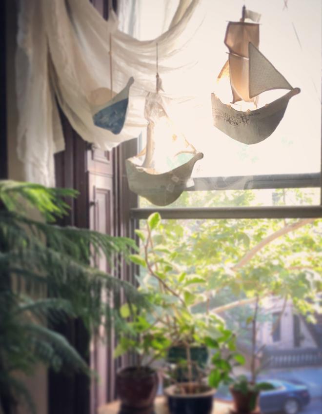 paper mache ships hanging in my window