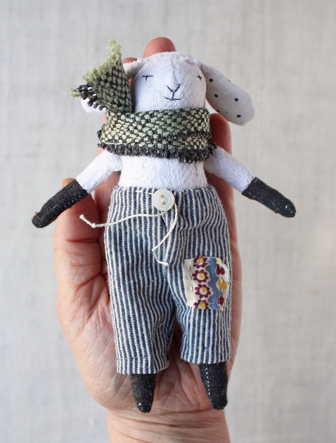 tiny lamb rag doll in pants