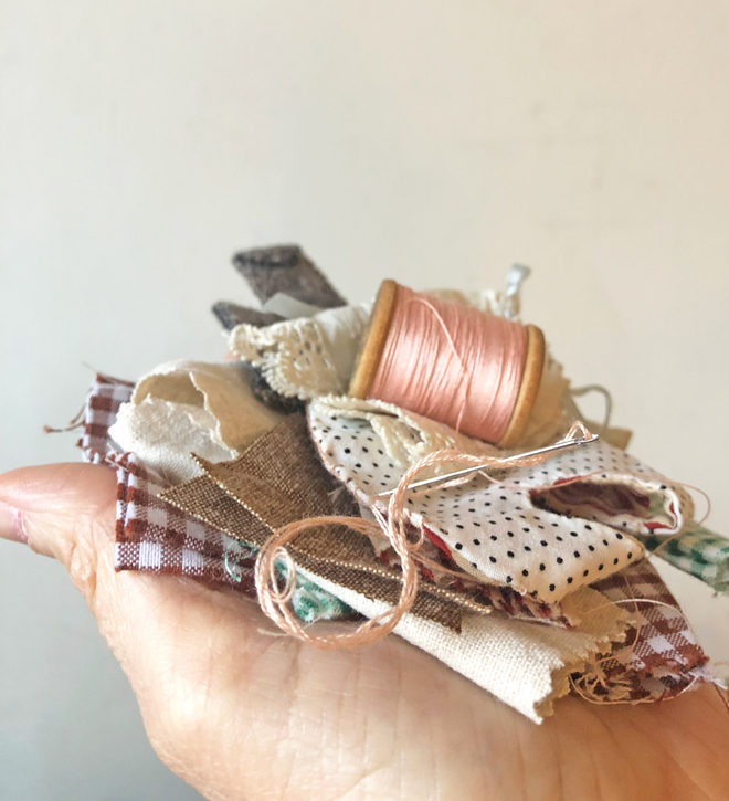 stack of tiny doll clothes
