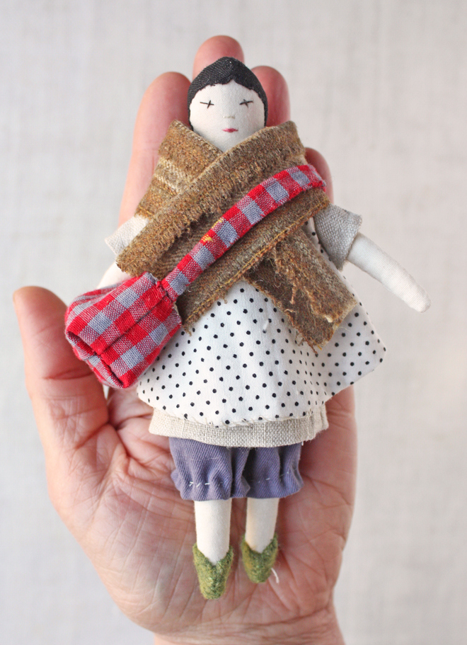 tiny rag doll with satchel
