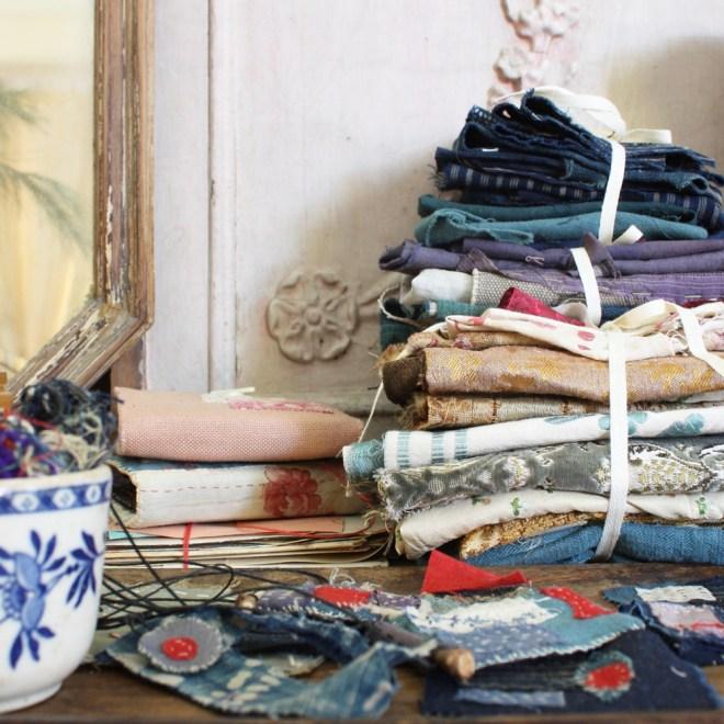 stacks of antique fabric scraps