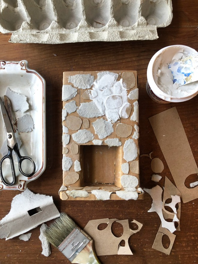 making a miniature fire[lace form egg cartons