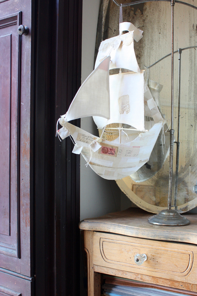 paper mache ship collaged with antique paper