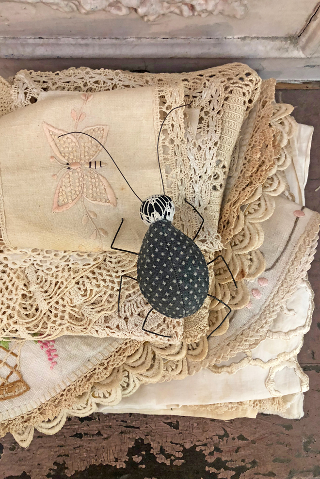 antique linens and a textile beetle