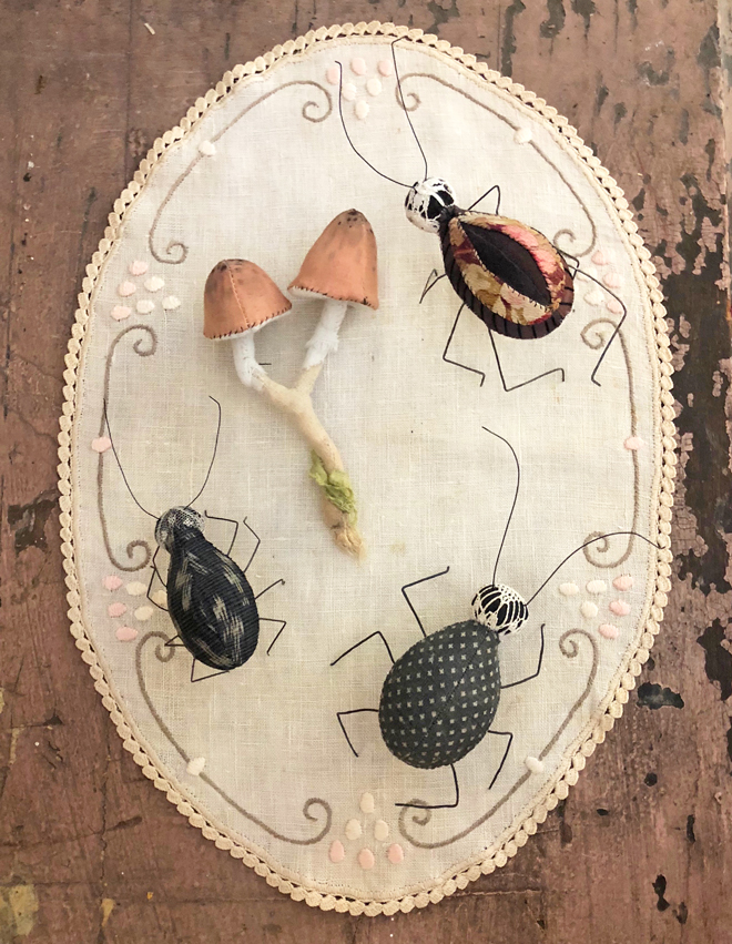 hand stitched beetles and mushroom