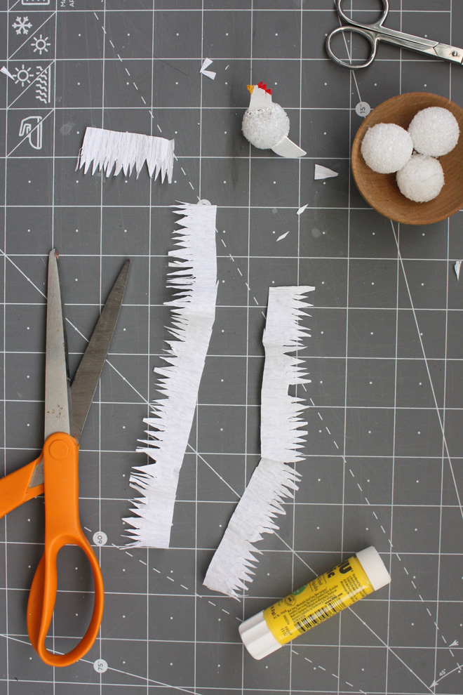 cut paper hen feathers