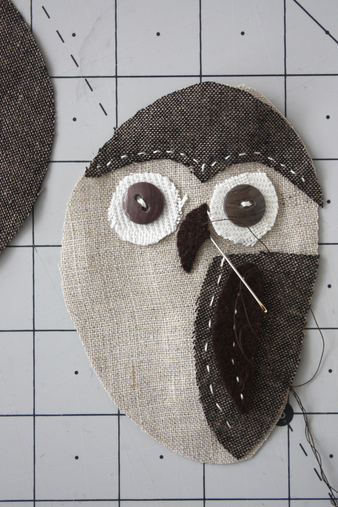 stitching the beak in place