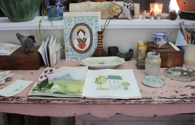 art and drawing supplies on a pink desk