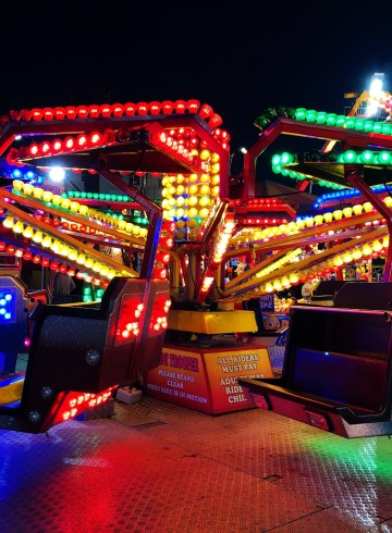 fairground at night with neon lights
