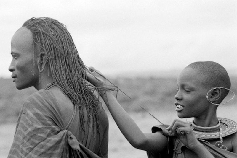 Maasai Warrior with girlfriend measuring his hair.