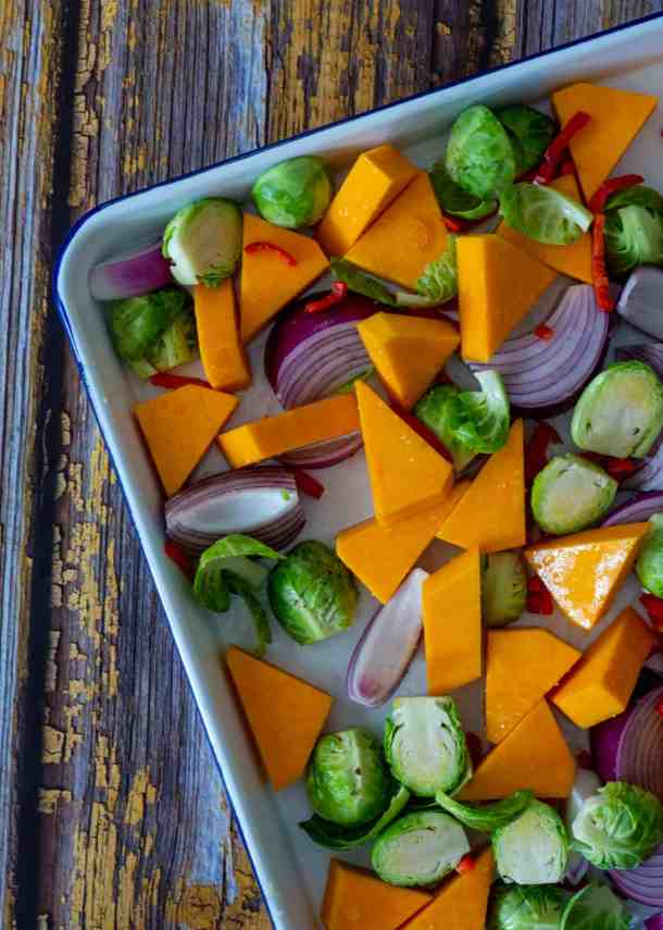 raw vegetables on a roasting tray