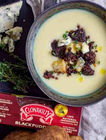 Potato & leek soup with clonakilty black pudding next to it