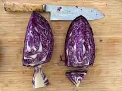 cut red cabbage & chefs knife on board
