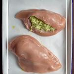 jalapeno popper stuffed chicken on a baking tray