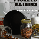 raisins, sugar & red chili flakes in kilner jars, global chef knives and a scanpan pot on kitchen counter top