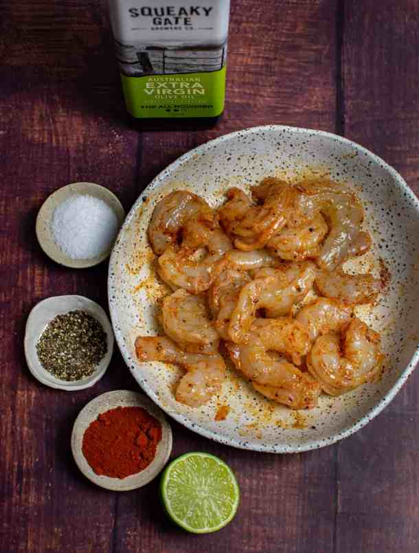 marinated prawns in a bowl, spices and squeaky gate olive oil