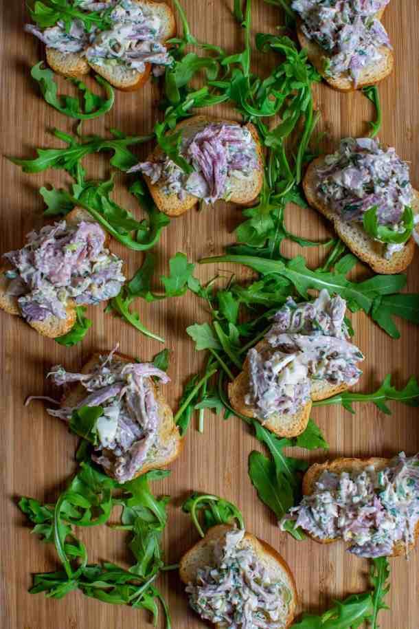 braised ham hock salad on top of crostinis