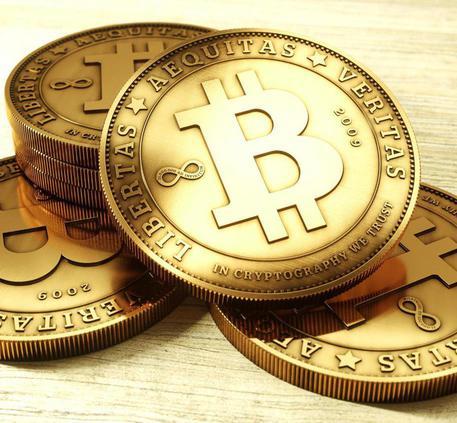 Monete con il simbolo Bitcoin © ANSA