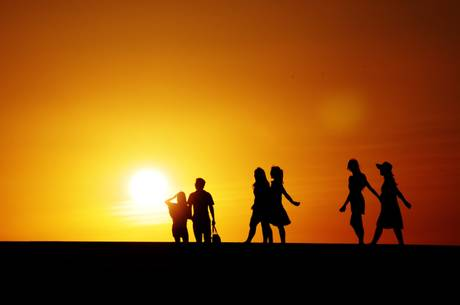 People play in the sunset at a seashore park [ARCHIVE MATERIAL 20100621 ]