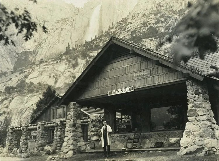 Harry Best in front of Best's Studio in Yosemite National Park, which still stands today as The Ansel Adams Gallery