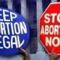 A foetus is not a person, so abortion is morally permissible.