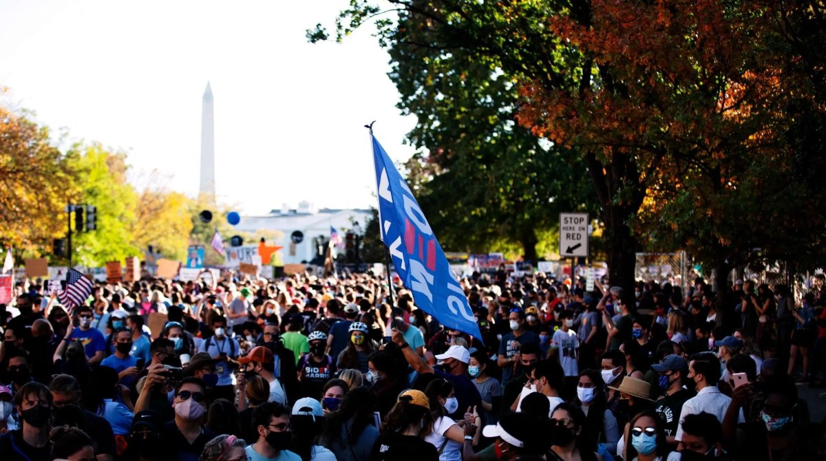 Biden voters and supporters at Black Lives Matter Plaza, (north side of the White House) Washington D.C., to celebrate the Biden/Harris 2020 election win.   7 Nov 2020   Photography Credit: Johnny Silvercloud