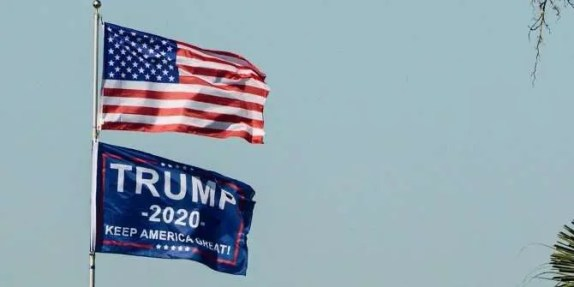 Image showing a flagpole with an American Flag above a Trump 2020 political flag