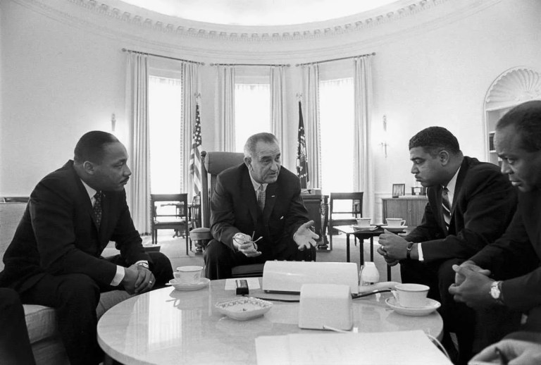 Black and White Image of President Lyndon B. Johnson in the Oval Office Meeting With Civil Rights Leaders in 1964