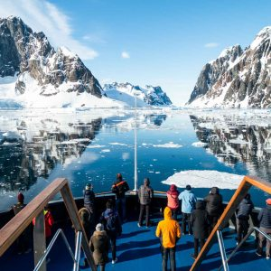 Travelers crossing Lemaire channel, in Antarctica, aboard Magellan Explorer. Photography by Sandra Walser.