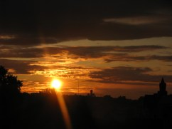 The sun melts into the horizon in West Berlin.