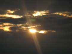 The light of day slowly fades behind clouds.