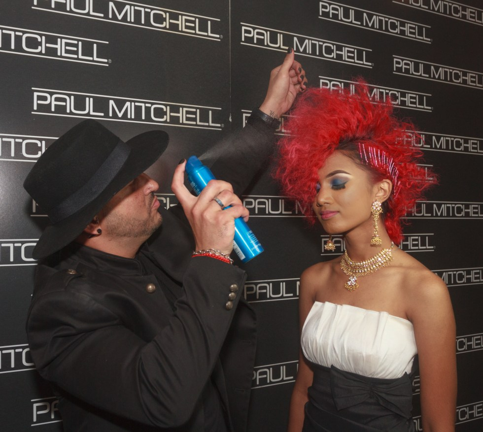 John Paul Mitchell International Educator, Luis Rivera sprays Neuro Liquid to style the hair of a model at the Courtyard Marriott, Port-of-Spain.