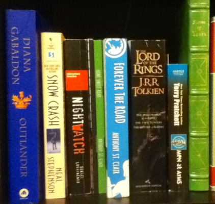 On the shelf with Lord of the Rings, Nightwatch, Outlander, and more cool fantasy books