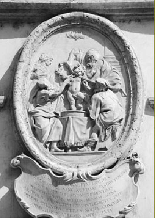A depiction of the bestial act - a stone carving shown 0n a church in Italy