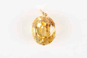 A large yellow sapphire in a pendant mount