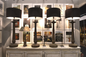 Cast iron mid-C19th Empire style columns as lamps, with photographic prints by Sam Haskins, at La Place Antiques