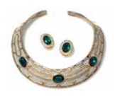 "Collar and earrings set designed by Les Bernard with ""emeralds and diamonds"" in gold tome metal"