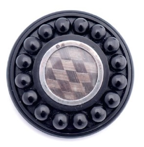 An antique Whitby jet brooch using plated and woven hair as its centrepiece surrounded by jet spheres, W. Hamond, £535